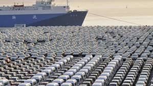 Chinese cars wait to be exported at a port in Dalian, Liaoning province. (China Daily/Reuters)