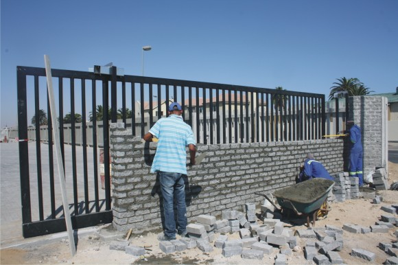 Workers putting the final touches to the entrance to the Botswana dry port. [Photo - Floris Stenkamp]
