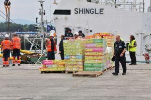 Revenue officials unload the Shingle at Dublin Port after 32 million cigarettes were seized [Picture: Irish Mirror]
