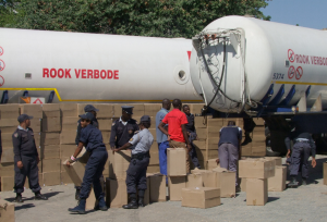 Namibian police inspect over 1,000 boxes of impounded cigarettes at a roadblock in Rundu [Coastweek]